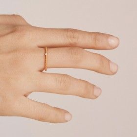 Rebel gold ring hand