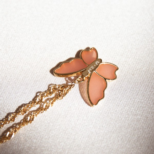 Butterfly gold necklace detail
